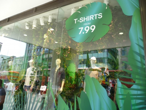 H&M summer window display seems inspired from jungle, forests and freshness.