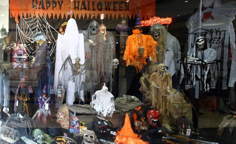 Scarry costumes representing zombies or ghosts, placed in the window display for a happy Halloween.