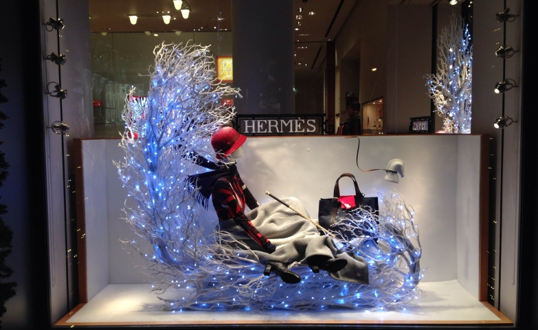 Hermes window display from Beirut has a bed made from white branches, with little blue lights suggesting the winter coolness.