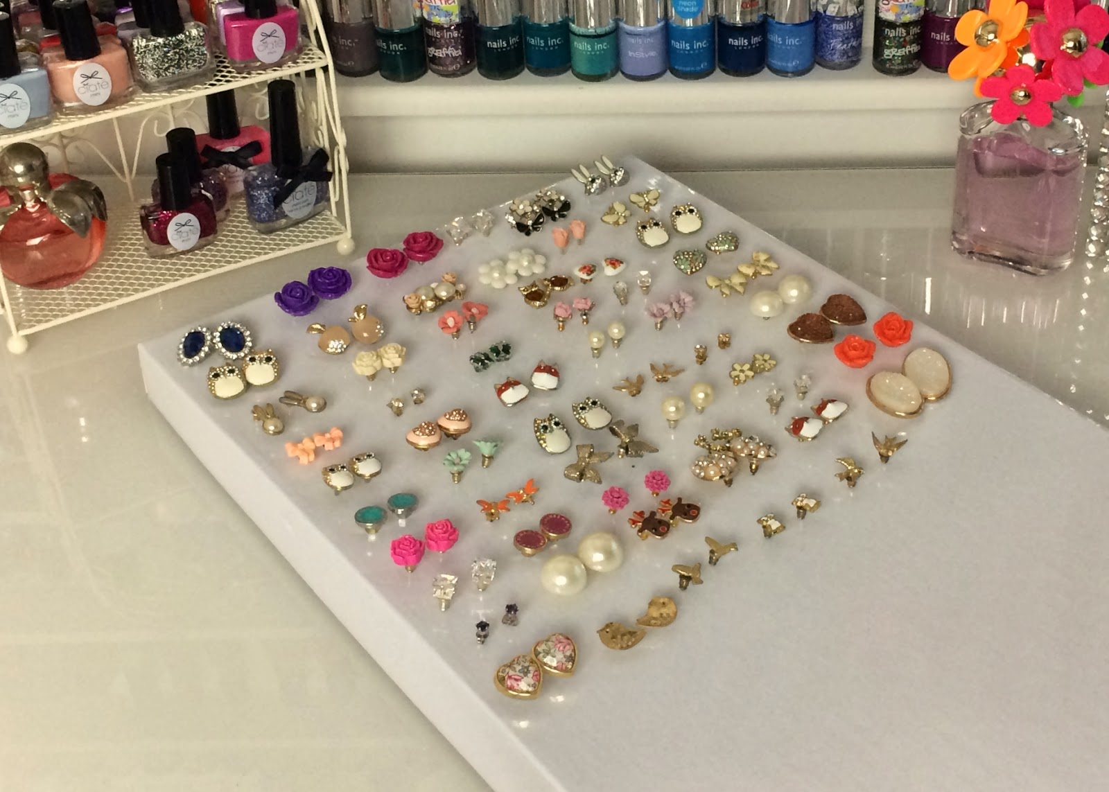 In a cheap and also creative way, you ca have a jewelry holder, by pinning the earring into a foam panel.