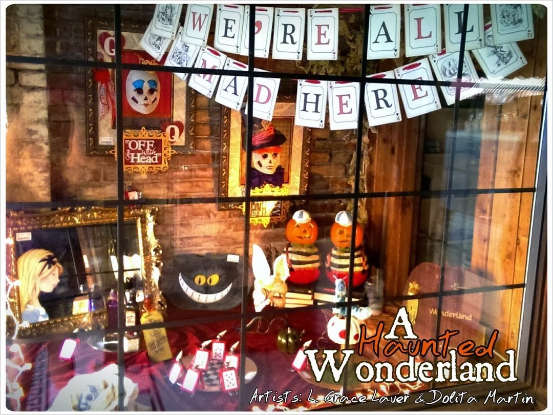 Alice in wonderland and Halloween made a perfect combo for a haunted window display.