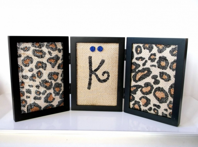 Designed in a creative way, for a better standing on the desk. It is easy made from a frame and with animal print sail, perfect as a jewelry earring holder.