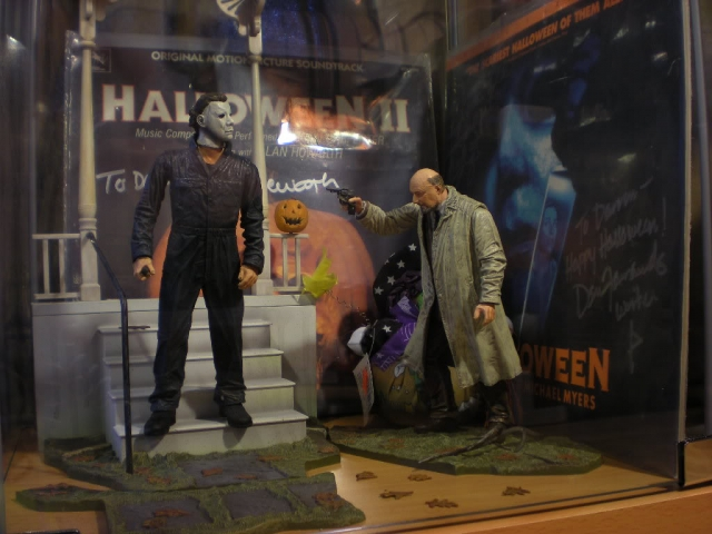 Two characters from a horror movie confronting each other in the Halloween window display, a scary scene suiting this holiday.