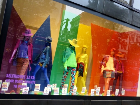Their inspirational summer window display is designed with such vibrant colors.