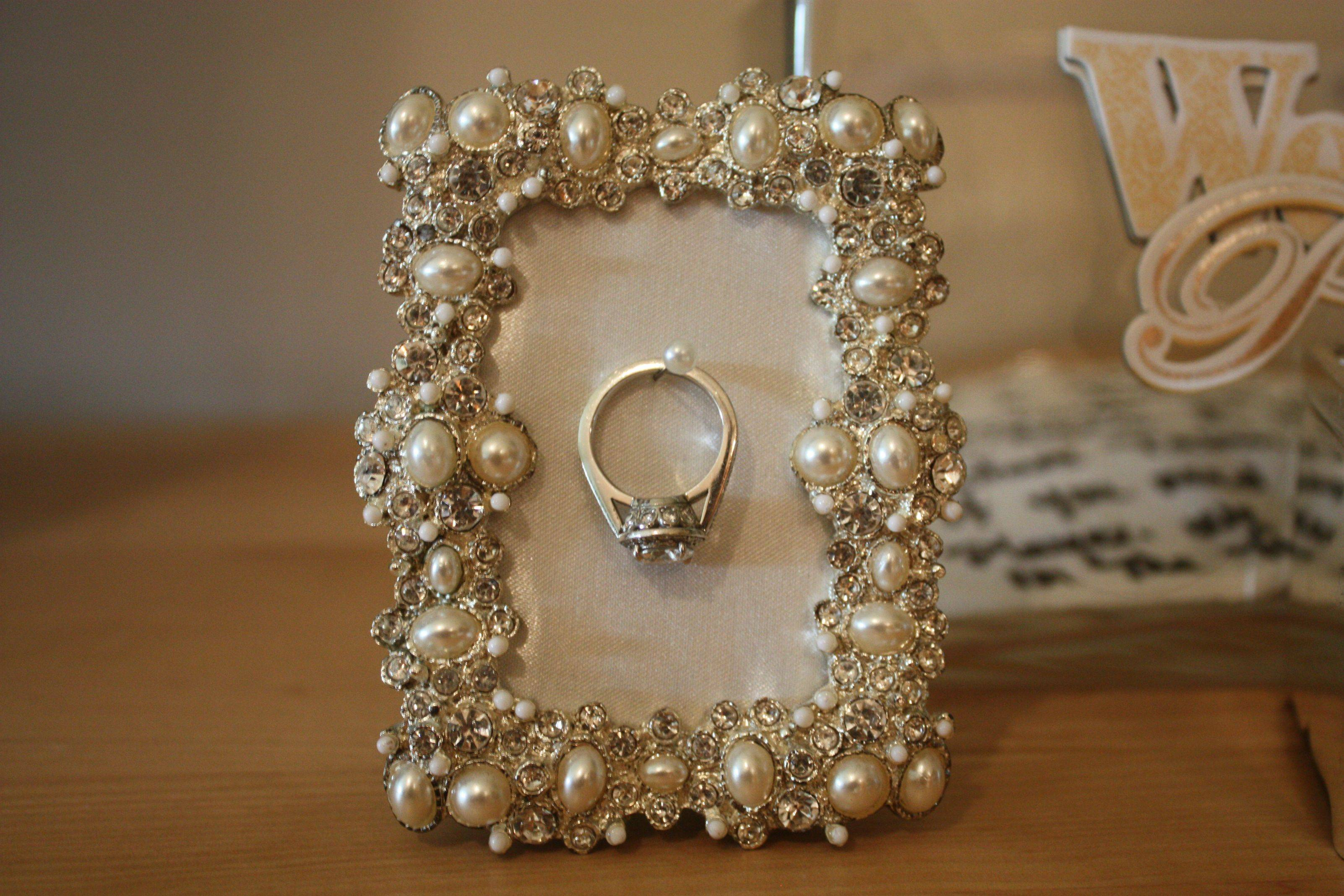 For someone who likes something delicate, a creative jewelry ring holder could be a frame, with pearls on every border and a pin in the middle of it.
