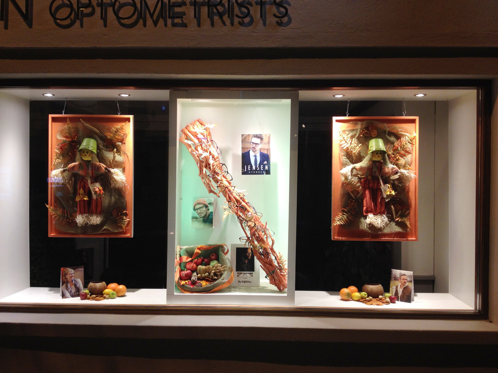 Framed puppets, brown shades and pumpkins marked this autumn window display.