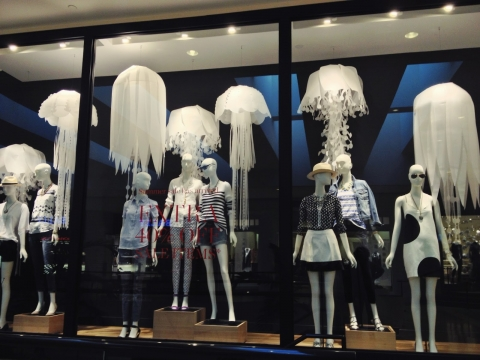 Black and white never looked so good in a window display for summer decorated so interesting with paper jellyfish.