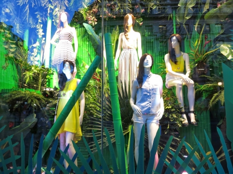 Seems that the green jungle idea is one of the most frequent ways to decorate a summer window display.