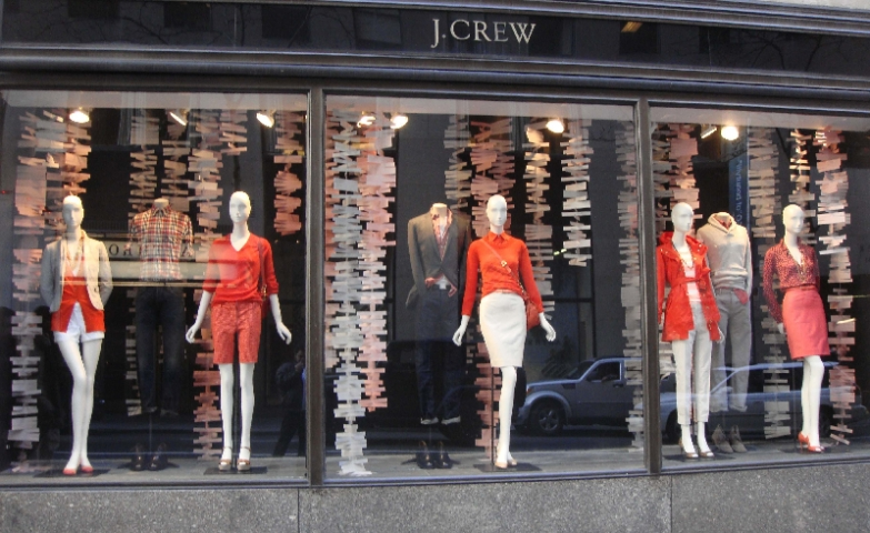 J. Crew chose different shades of red and some hanging cut-paper for its autumn window display.