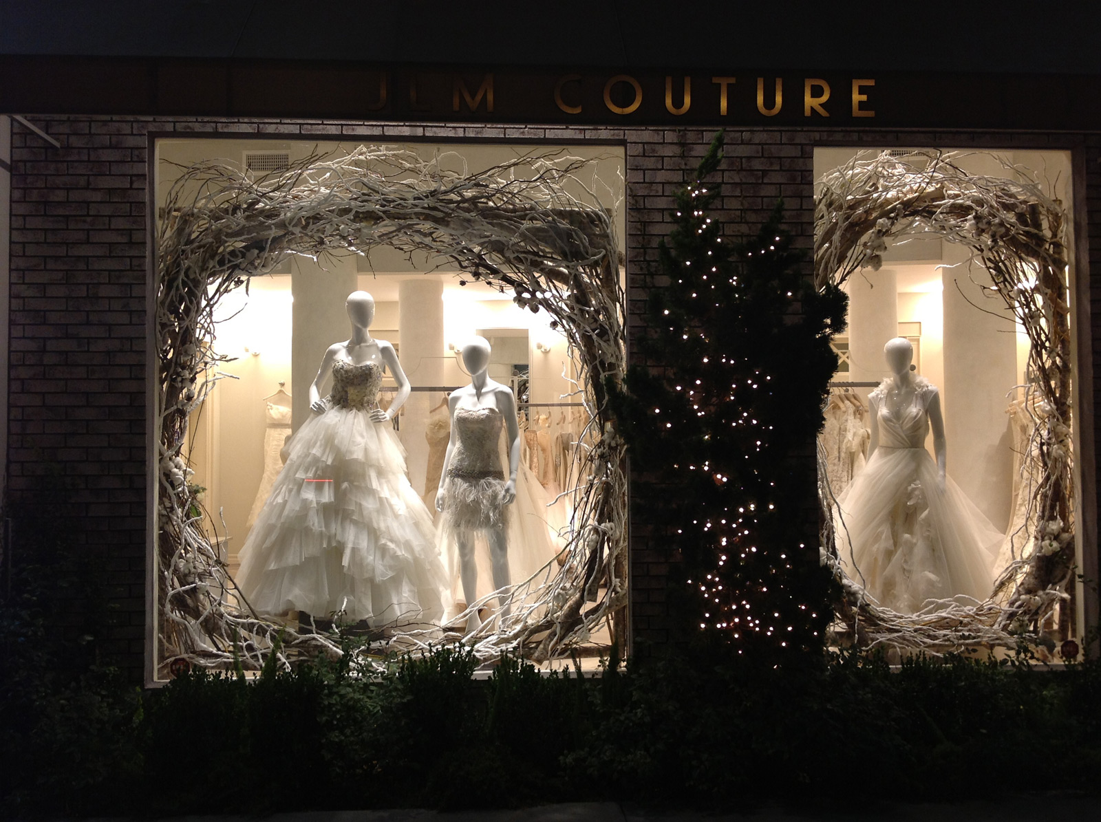 Jim Couture brings the purity and innocence into the window display with those white dresses for brides and with the big nest placed on the window.
