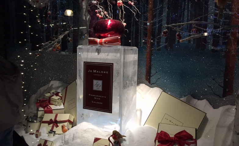 In the Jo Malone winter window display is a big perfume recipient, surrounded by presents box, all in snow.