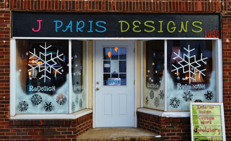 Some choose to have a simple yet cute window display design, as J Paris Design did it, with spray and winter shapes like snowflakes.
