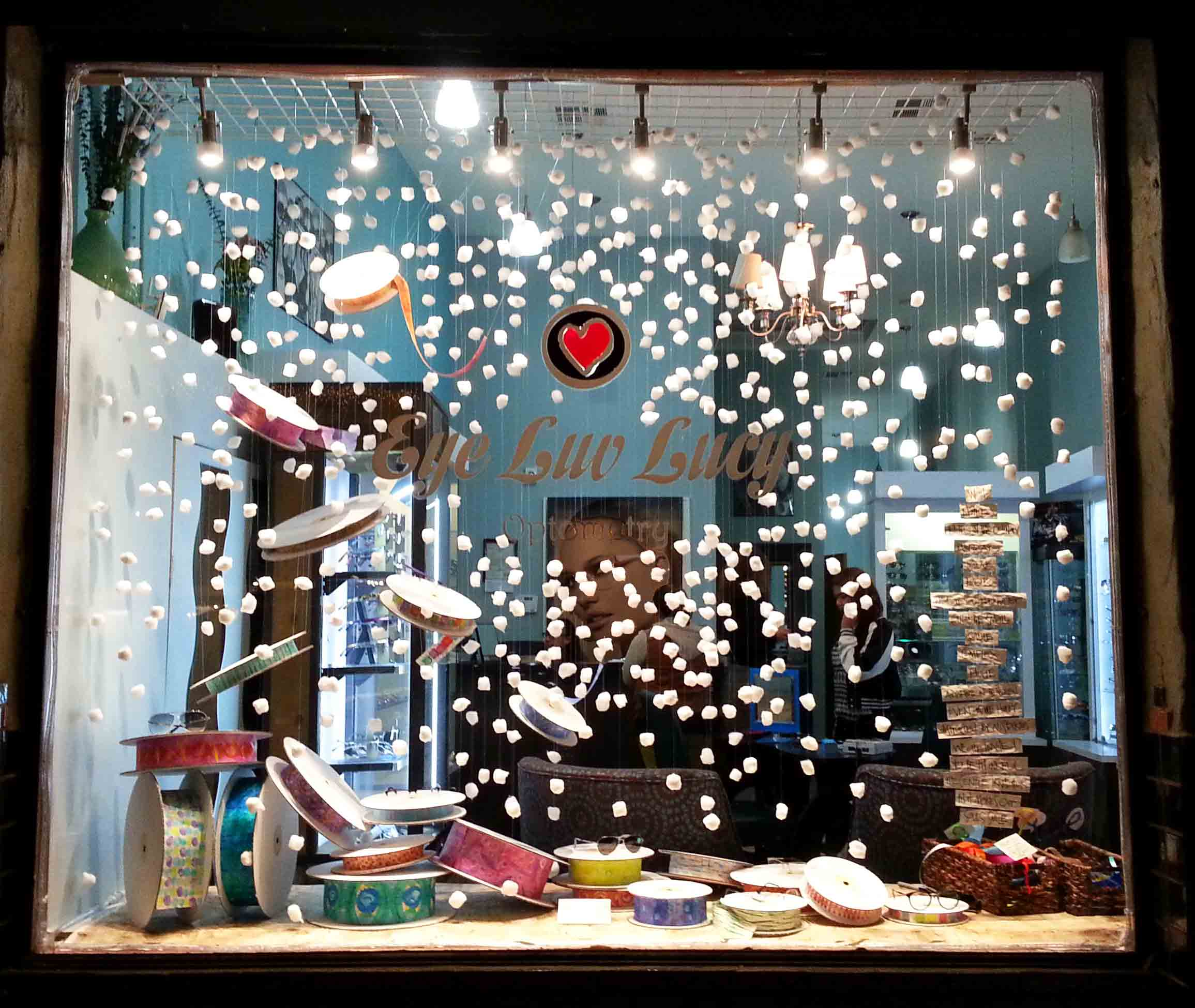 """In this winter window display, we have many tinsel and the idea of """"let it snow""""."""