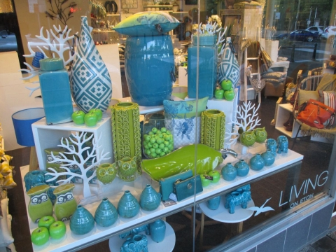 Living on Eton summer window display has some blue and green items that look like grass and sky on summer.