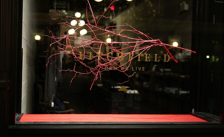 Litchfield represented the winter through a red branch hung in the window display.