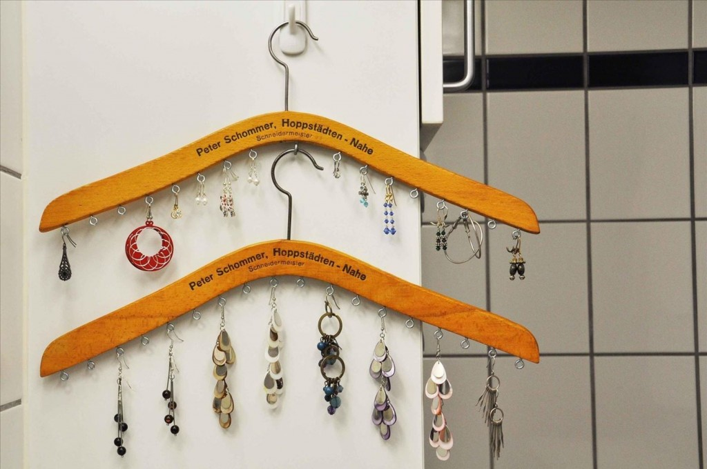 All you need are as many hangers as you want, some hooks added ad the bottom and now you have a creative jewelry earring holder.