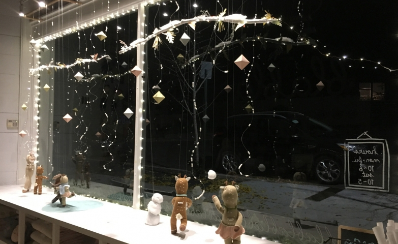 In this cute winter window display for a kids store, we can observe a few little reindeer dancing in the snow.