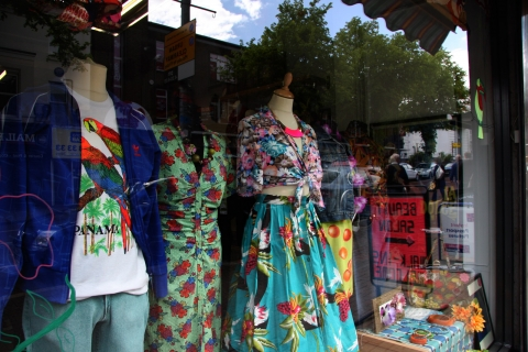 A lively way to decorate a window display for summer, with loud tropical prints put on mannequins.