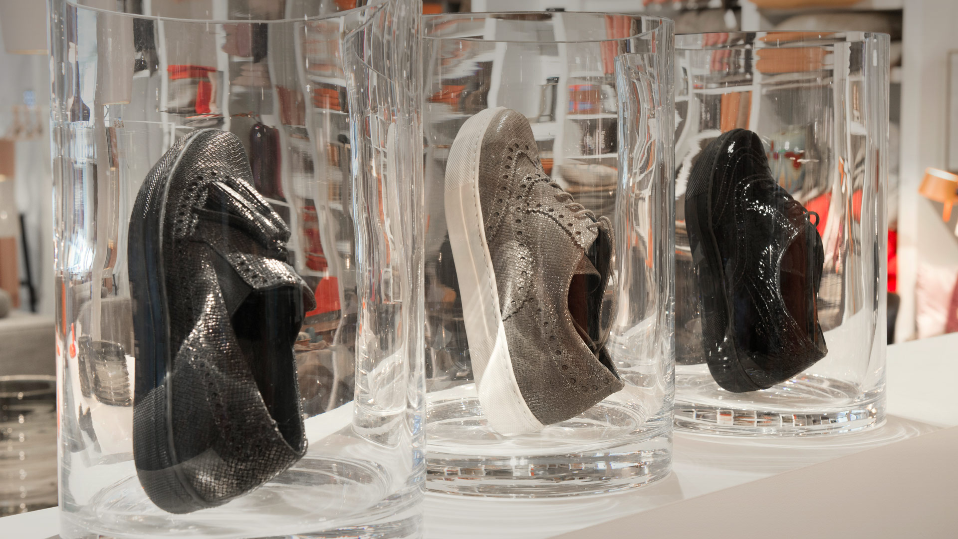 You can show in the autumn window display that the shoes you sell are appropriate for the weather, by placing them in huge water glasses. This may be suggestive for water proof.