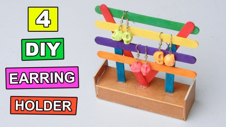 Don't throw the sticks after you eat the ice-cream. Use them to have a creative jewelry earring holder. Stick them in a box and paint them in different colors.