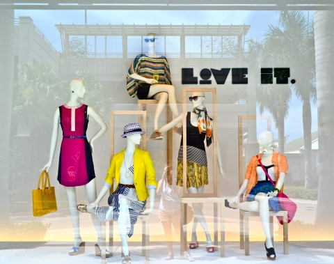 Summer window display focused on a happy type of clothes and a message that comes to your mind when you think about them.