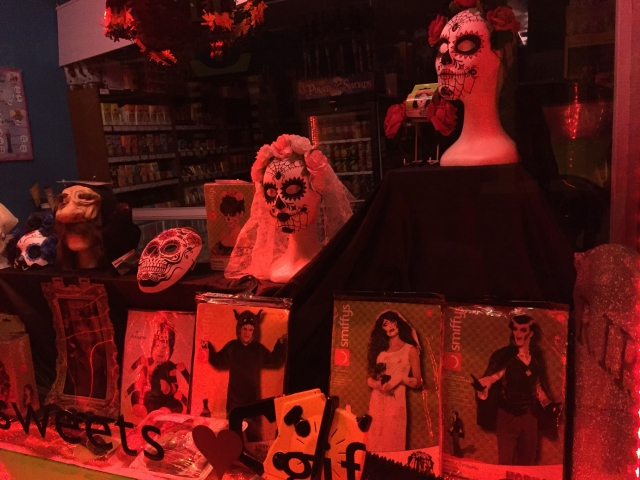 A window display for Halloween, with masks, costumes and probably other accessories.
