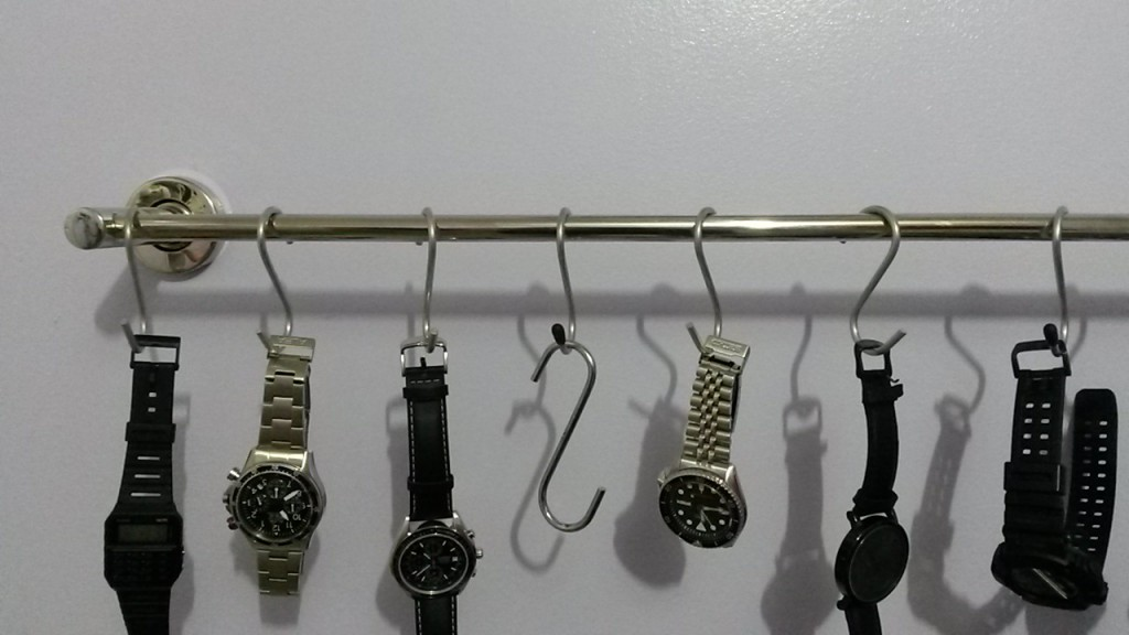 Attach to a metal bar a few hooks and you can have fast and creative jewelry watch holder.