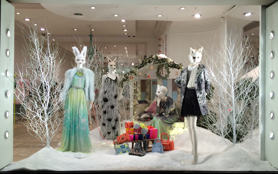 It seems that in this winter window display are three furry snowmen having a deep conversation.