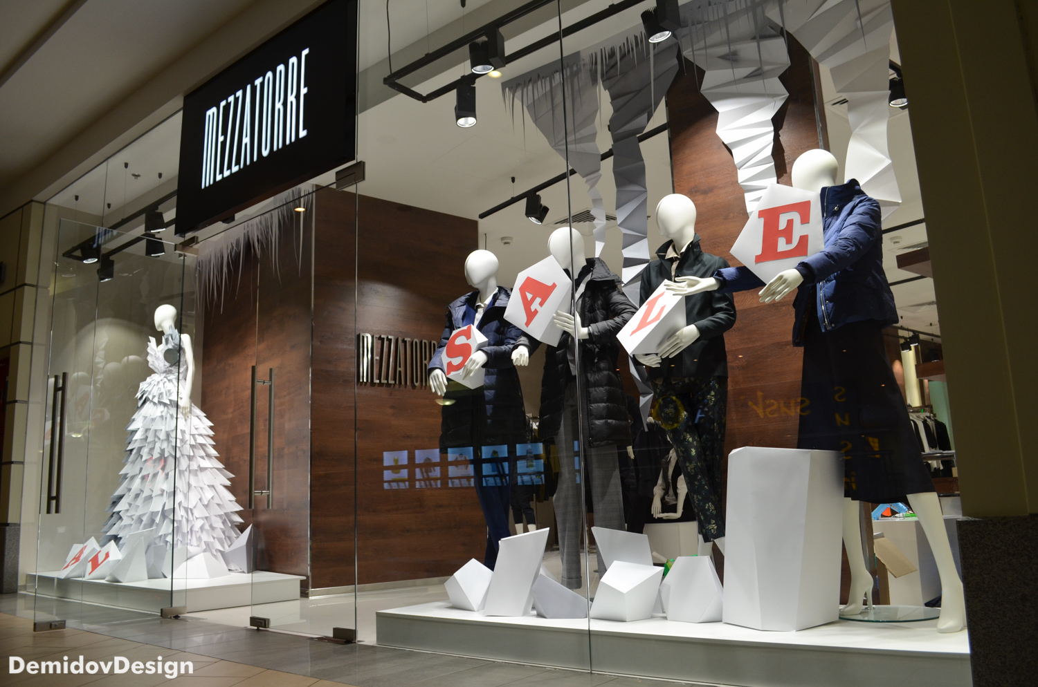 Mezzatorre is picking some white geometrics shapes for iced snow, thick clothes and sales message
