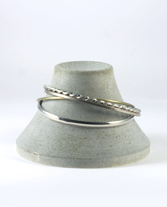This miniature volcano is a creative jewelry bracelet holder, part of a landscape series made of customised silicone mold.
