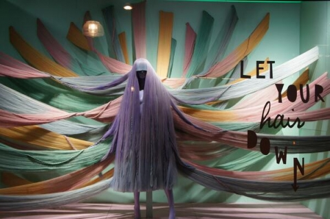 One of a kind window display expressed through pastel summer colors and a lot of hair.