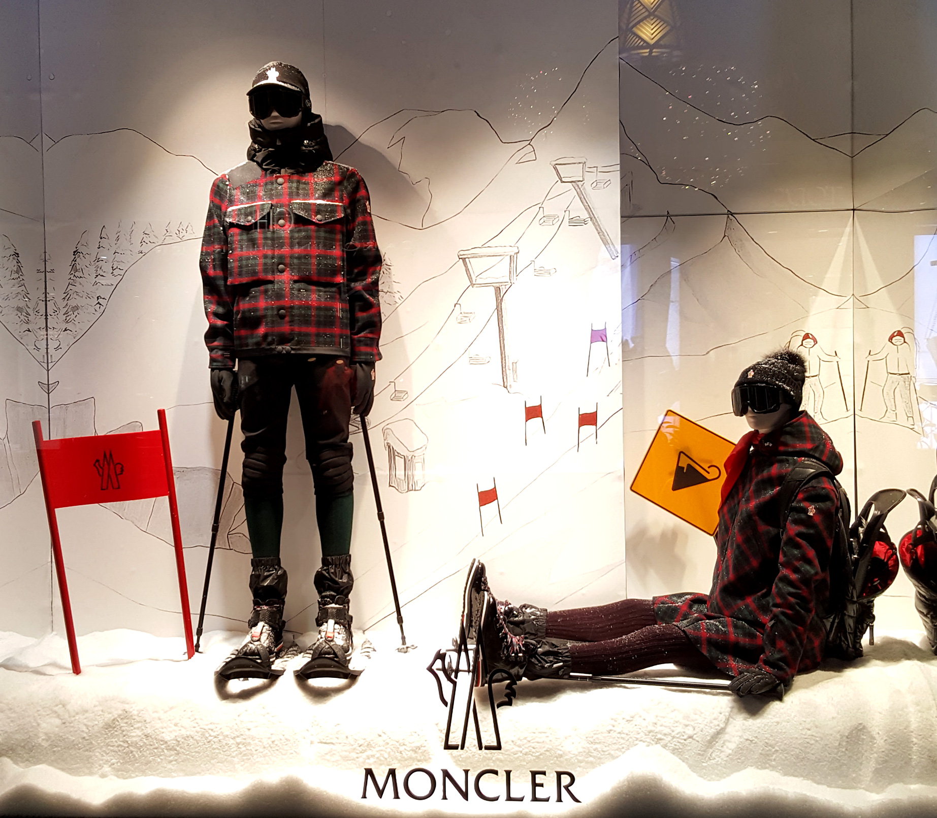 Monclaire has a background image with a ski track and also a fashion layout for winter in this window display.