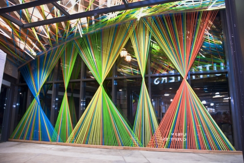 This is a pop-art inspirational summer display. Those colorful strips are mixed thoughts for the season.