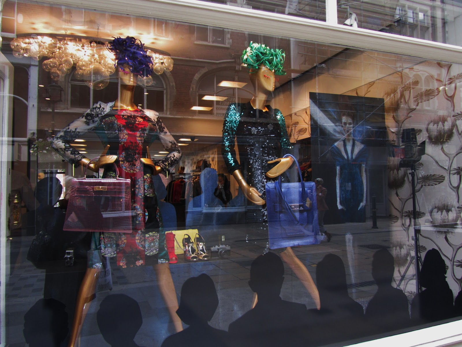 In this autumn window display, mannequins are waiting for a round of applause from the audience created out of stickers.