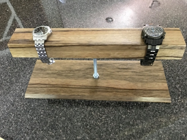 Creative jewelry watch holder, designed in a modern way from black limba wood, held up with galvanized steel.