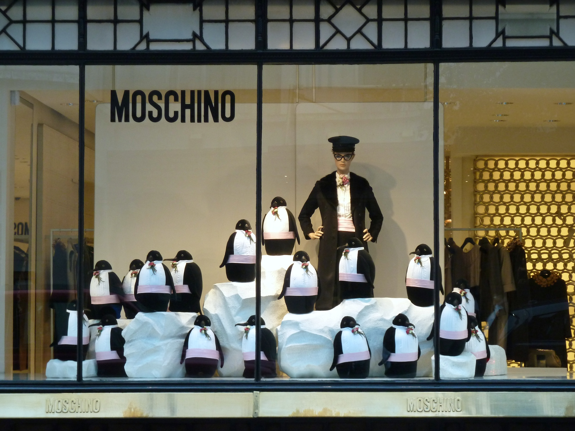 Always a pleasure for the eye to see a Moschino window display. This one is ready for winter with cute penguins in a dress suit.