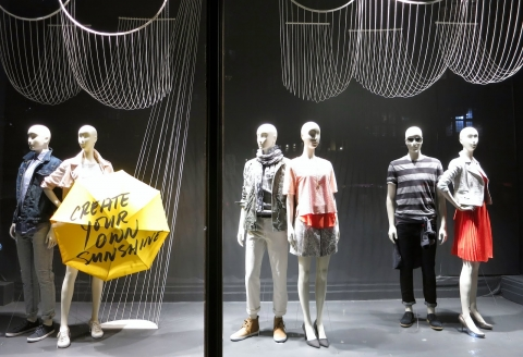 Some positivity thoughts wrote on a yellow umbrella, suitable clothes and this summer window display will rock.