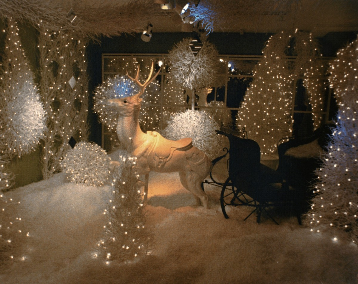 In this winter window display it is a reindeer made from natural fiberglass, a lot of foam and adorned firs with lights.