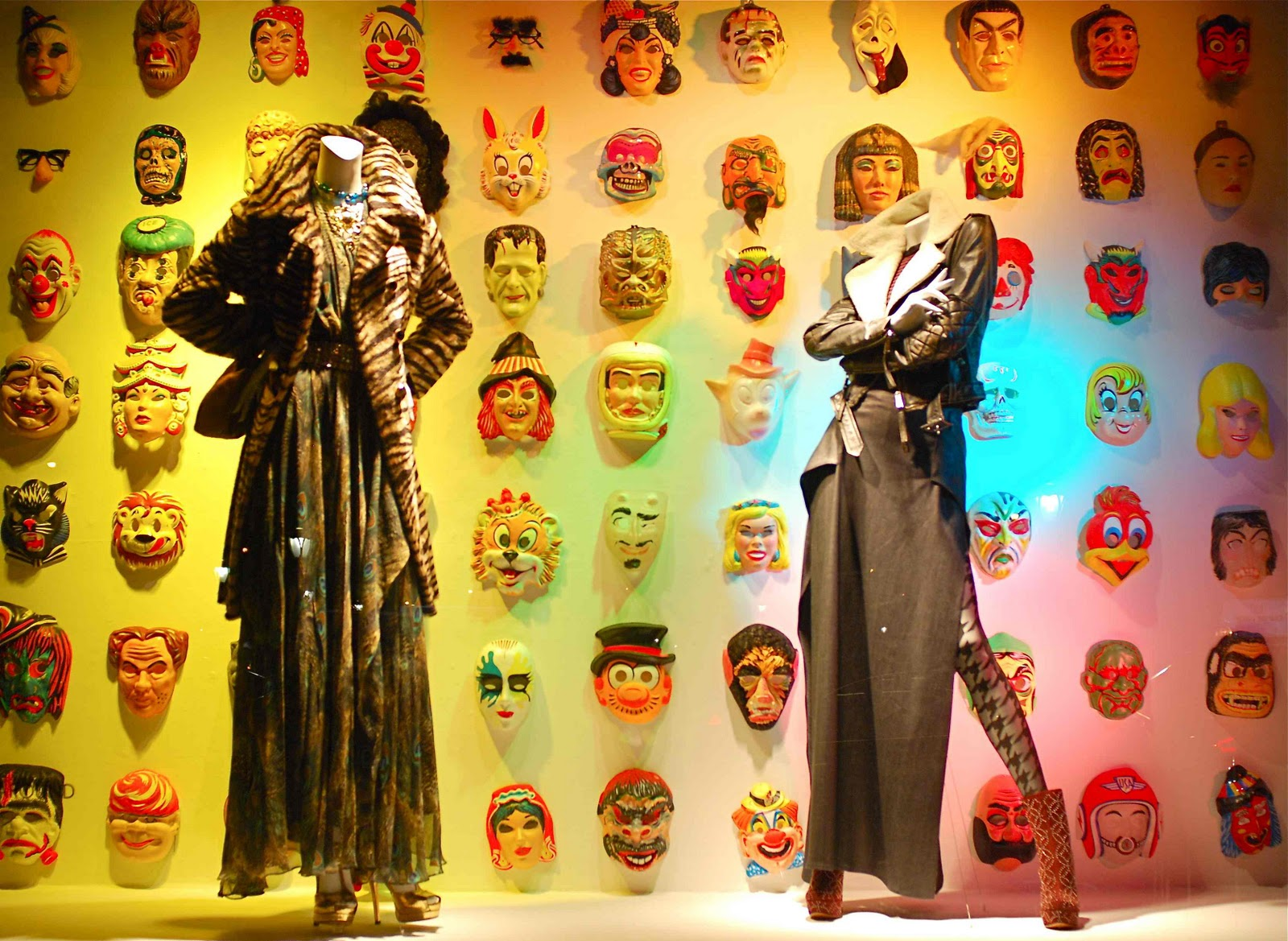 Plenty of masks hung on the back wall of the window display, representing characters for Halloween.