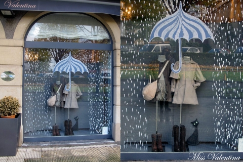 Draw an umbrella, a few rain drops like Miss Valentina did and the window display is ready for autumn.