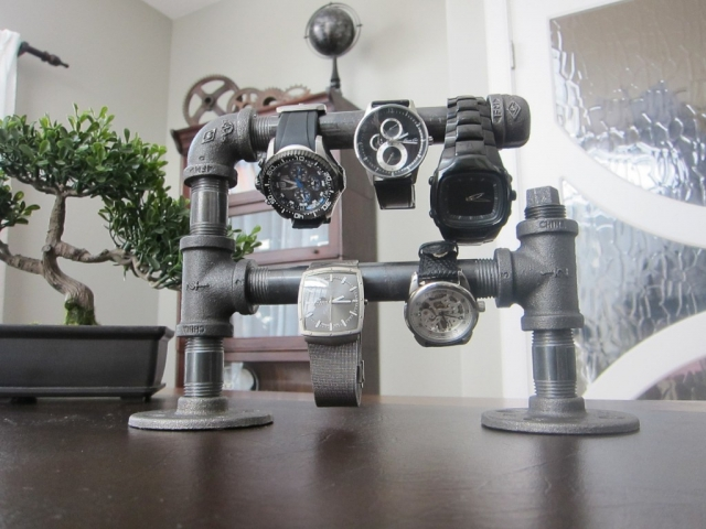 This is by far the most creative jewelry watch holder I've ever seen. It is made from old pipes.