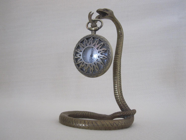 An original and unique, creative and antique, designed as a cobra for jewelry pocket watch holder.
