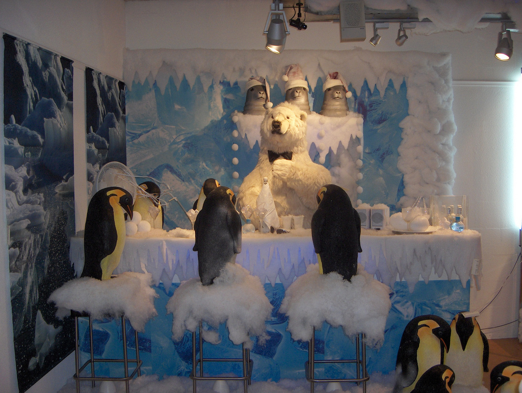 This is quite different from the others window displays as it's surprising a scene with some penguins staying at a winter bar and waiting to be served by a polar bear.