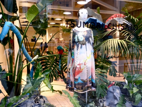 A store which picks real plants  for summer and for the tropical rainforest idea to settle the window display.