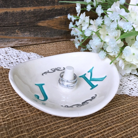 If you are into something delicate for a wedding, you could choose an oval, monogrammed creative jewelry ring holder.