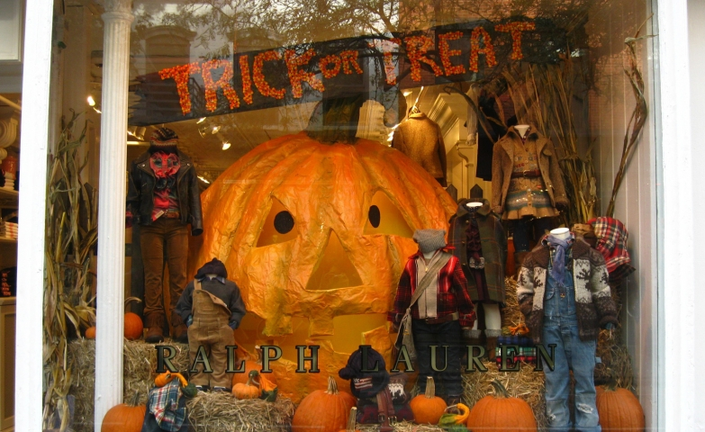 Ralph Lauren for kids decorated in a cute way with hay, trick or treat band and a big pumpkin which may be a tent.