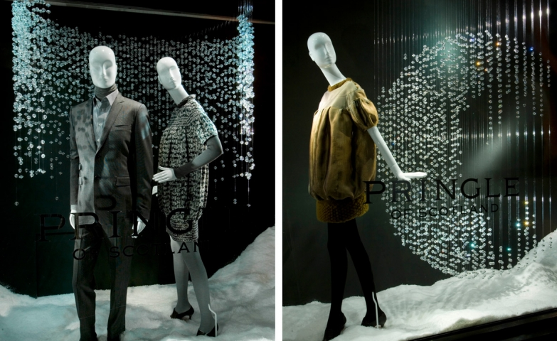 Here we have an elegant winter window display at Pringle of Scotland, with crystals hanging as frosty snowflakes and snow on the floor.