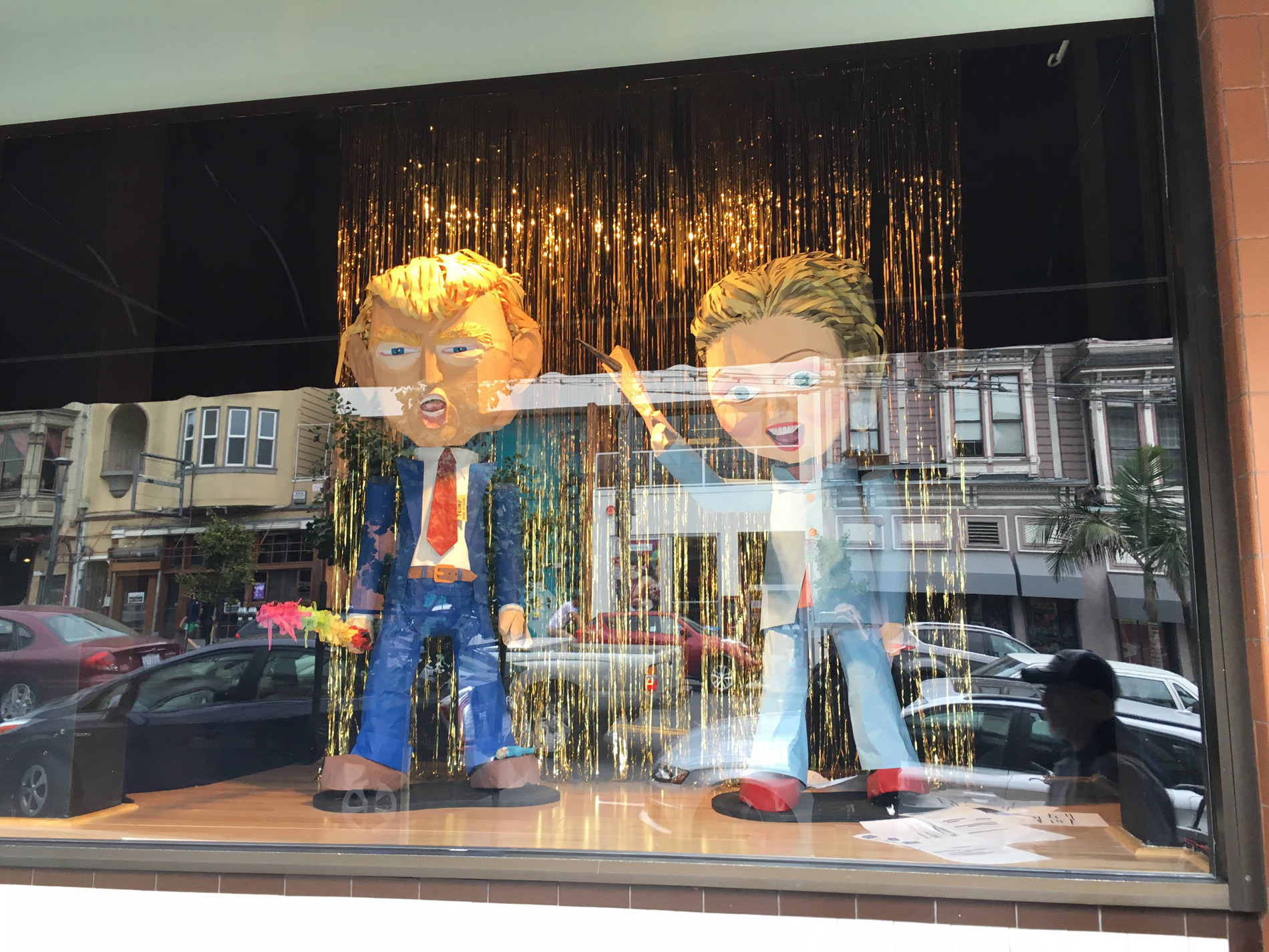 This must be the scariest Halloween window display ever, with these big puppets representing the president and his opponent.
