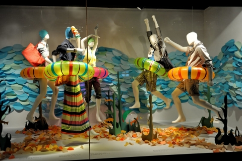 This window display shows some of the essentials for the summer: going to the beach for swimming and don't forget about the lifesaver.