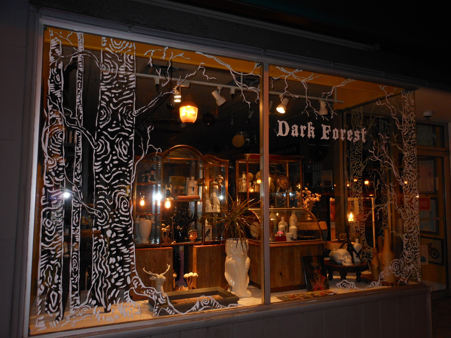 Scout Royal Oak, decorated for Halloween through some painting applied on the window display that looks like a dark forest.